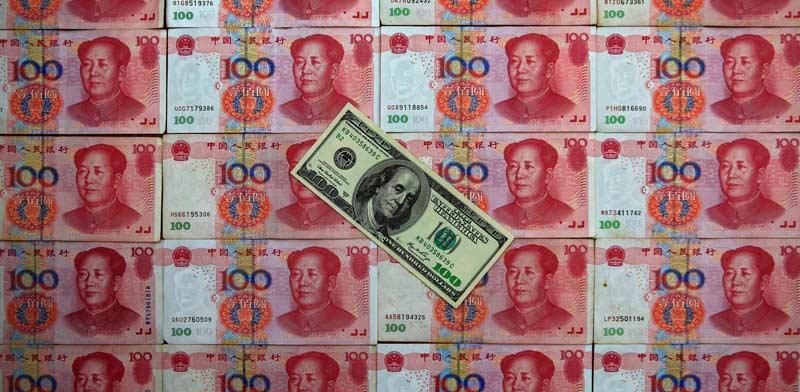 היואן הסיני והדולר האמריקאי / צילום: רויטרס  Petar Kudjundzic