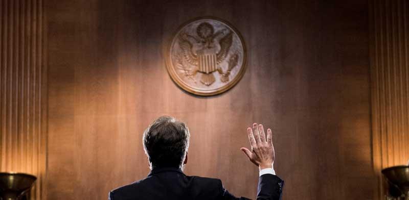 השופט ברט קאוואנו נשבע טרם השימוע בסנאט / צילום: רויטרס Tom Williams