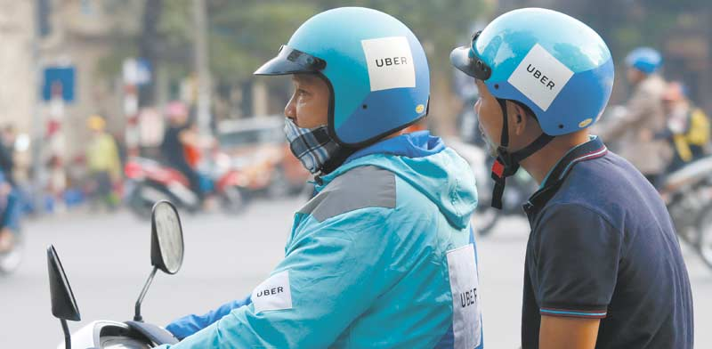 קארפול של אובר / צילום: Nguyen Huy Kham / רויטרס