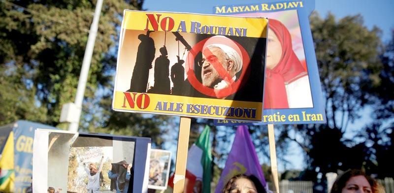 מתנגדי הנשיא רוחאני  / צילום: רויטרס, Tony Gentile