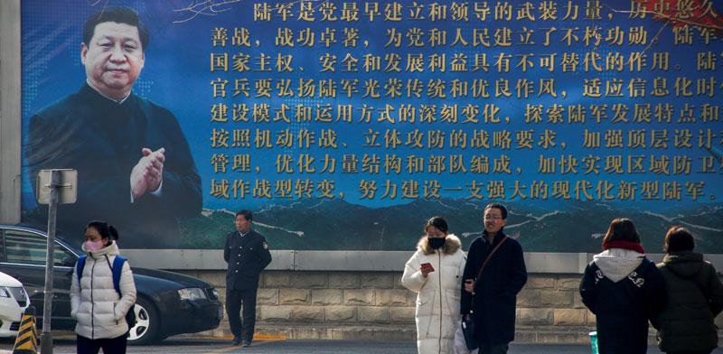 כרזה עם דיוקן הנשיא שי ג'ינפינג / צילום: רויטרס, Thomas Peter