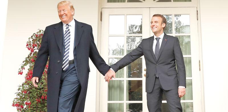 הנשיא טראמפ והנשיא מקרון / צילום: רויטרס