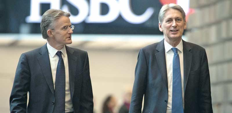 מנכל HSBC  ג'ון פלינט ושר האוצר הבריטי פיליפ האמונד/ צילום: איל יצהר