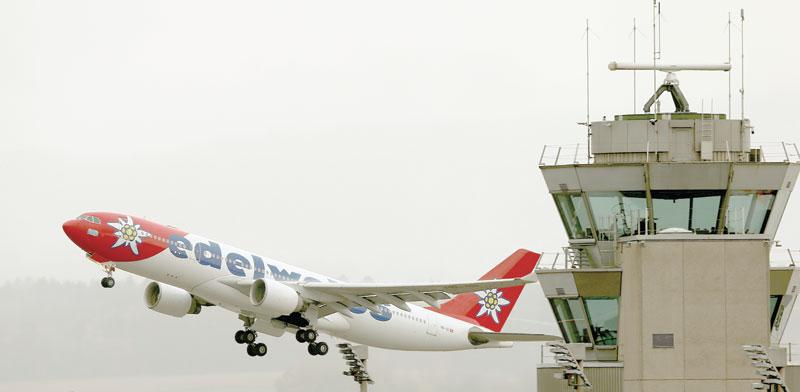 נמל התעופה בציריך / צילום: Arnd Wiegmann, רויטרס
