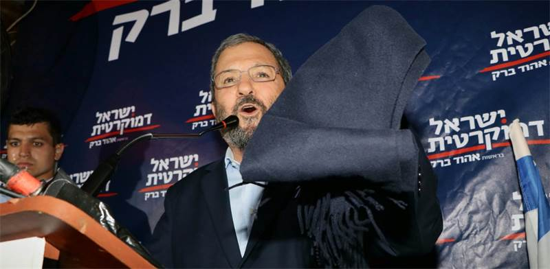 Barak brandishes the face covering showin in Daily Mail article / Photo: Amir Meiri
