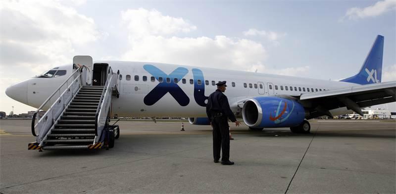 מטוס של XL Airways / צילום: מרקו דג'וריקה, רויטרס