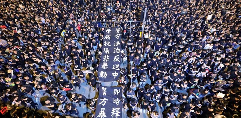 הפגנת ענק נגד מנהיגת הונג קונג / צילום: ATHIT PERAWONGMETHA, רויטרס