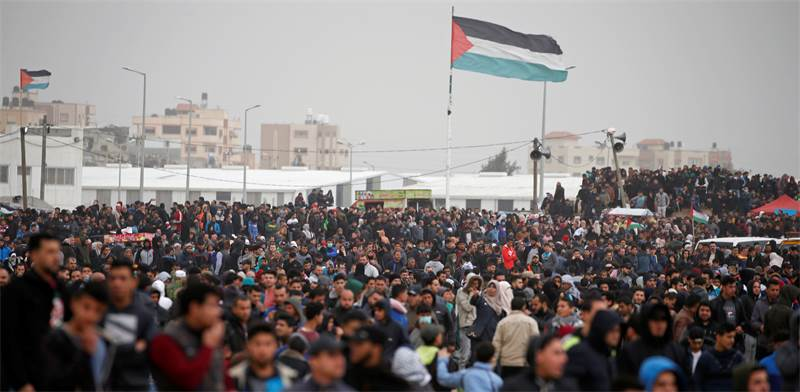 Palestinian demonstrators at Gaza Strip border