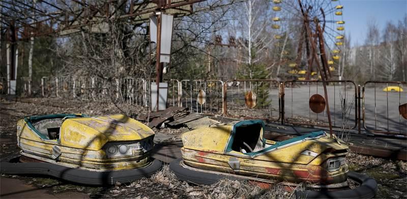 פארק שעשועים נטוש בקרבת צ'רנוביל / צילום: Gleb Garanich, רויטרס