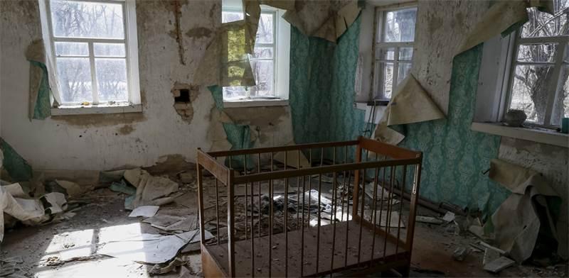 דירה נטושה בעיירה בקרבת צ'רנוביל / צילום: Gleb Garanich, רויטרס