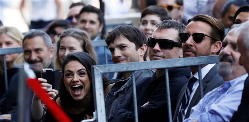 אשטון קוצ'ר ומילה קוניס / קרדיט: REUTERS/Mario Anzuoni