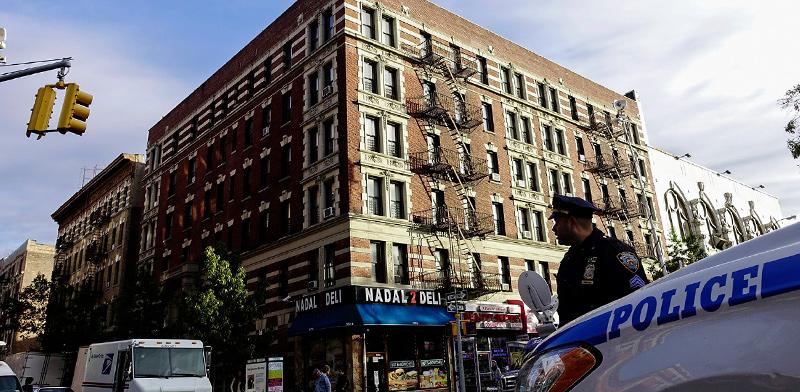 בניין דירות בהארלם / צילום: Eduardo Munoz, רויטרס