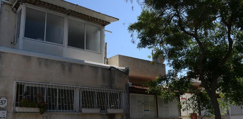 בית בשכונת שפירא בתל אביב, שבה קרקעות רבות רשומות במושע / צילום: איל יצהר, גלובס