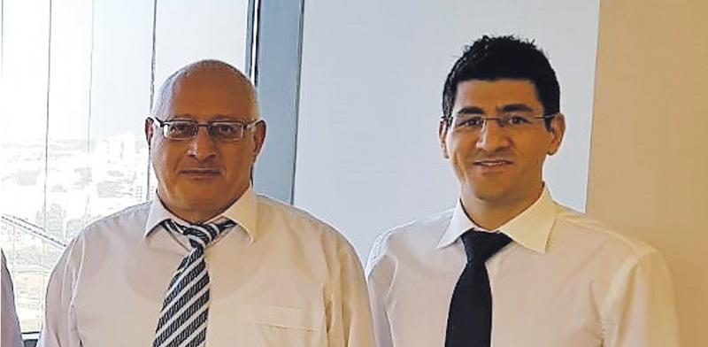 """אלי לוי (מימין) ואביו יוסי לוי, מנכ""""לים משותפים במור בית השקעות / צילום: יח""""צ"""