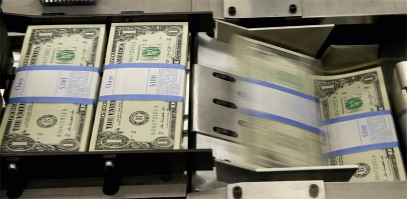 הדפסת דולרים בוושינגטון / צילום: REUTERS/Gary Cameron