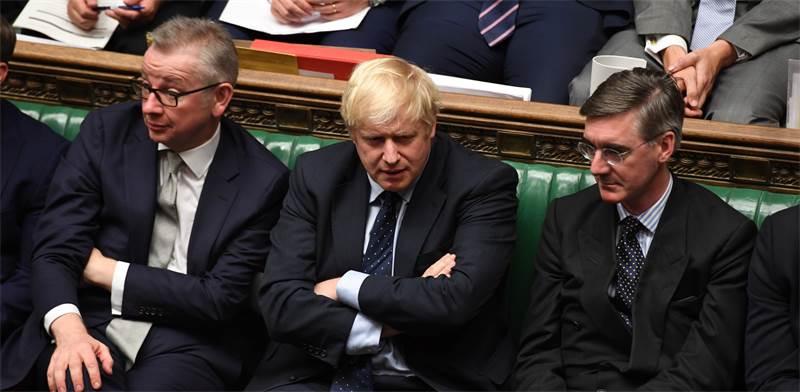 ראש ממשלת בריטניה בוריס ג'ונסון (במרכז) אתמול / צילום:  UK PARLIAMENT/JESSICA TAYLOR, רויטרס