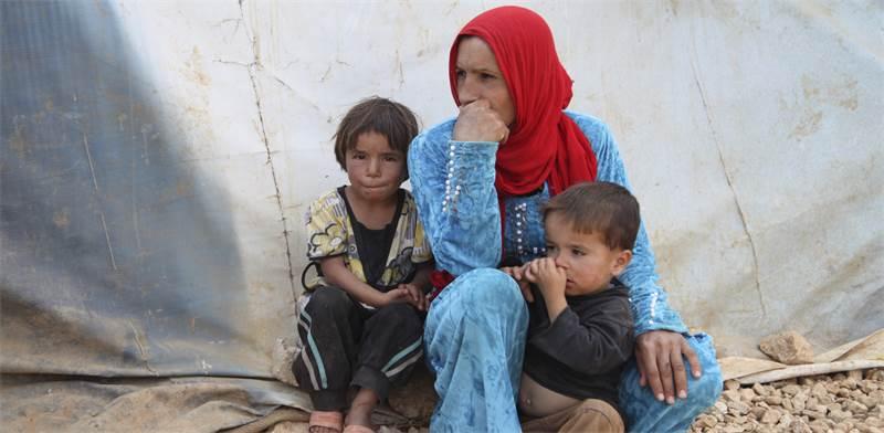 משפחת פליטים סורים / צילום: Alia Haju, רויטרס