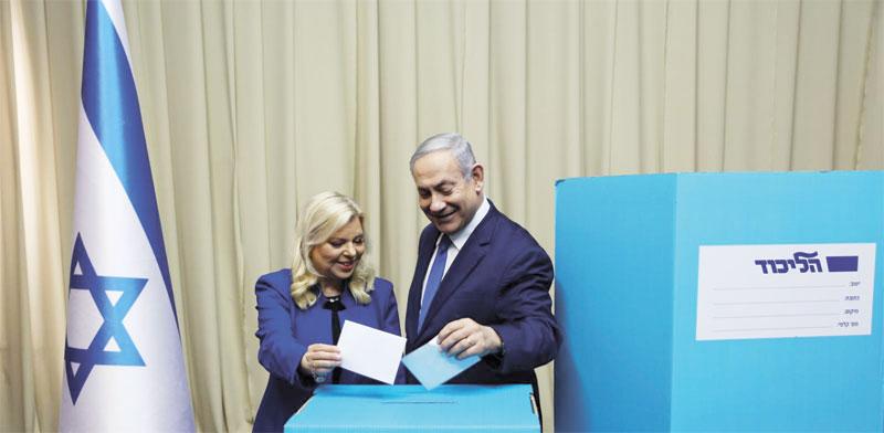 בנימין ושרה נתניהו מצביעים / צילום: הליכוד