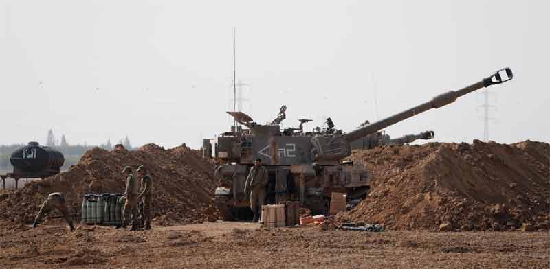 """תותח של צה""""ל בגבול הרצועה / צילום:  רויטרס"""
