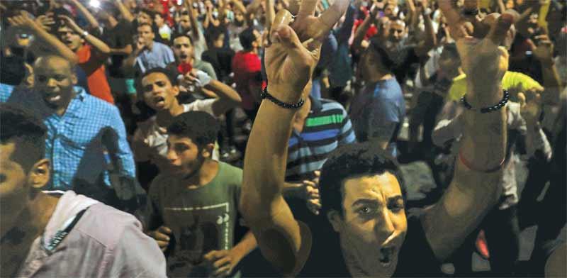 המפגינים בכיכר תחריר / צילום: רויטרס