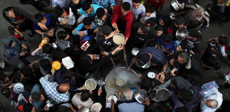 חלוקת מרק בעזה/ צילום: רויטרס, Mohammed Salem