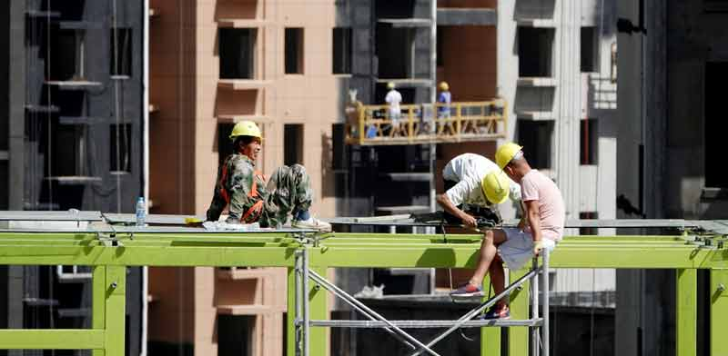פרויקט בנייה לדיור בסין / צילום: רויטרס