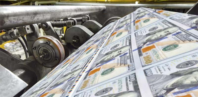 מכונת דפוס של דולרים / צילום: Shutterstock, א.ס.א.פ קריאייטיב