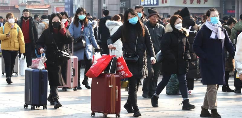 תושבי סין עם מסיכות פנים / צילום: Koki Kataoka, רויטרס