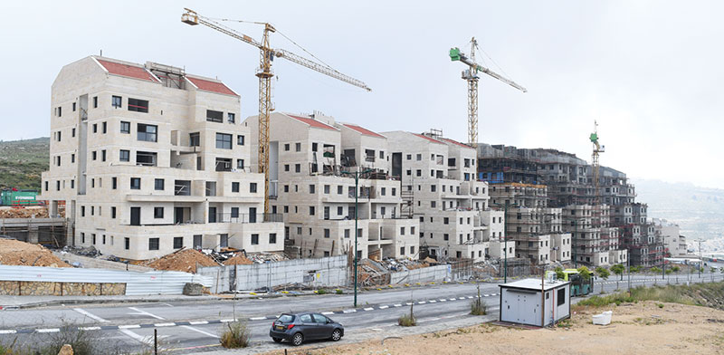 Homes under construction / Photo: Rafi Kotz, Globes
