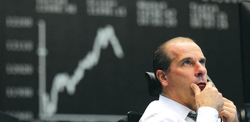 """הבורסה לניירות ערך של פרנקפורט, ביום הבחירות בארה""""ב / צילום: Kai Pfaffenbach, רויטרס"""