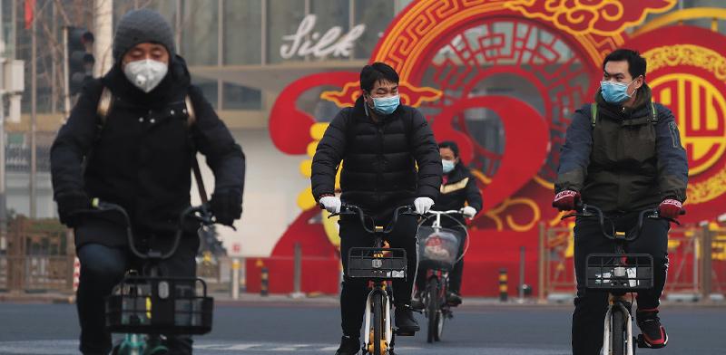 תושבים בבייג'ינג / צילום: Koki Kataoka, רויטרס