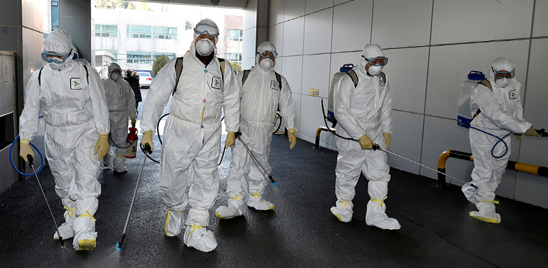 Disinfecting against the virus  / Photo: Yonhap Reuters , Reuters