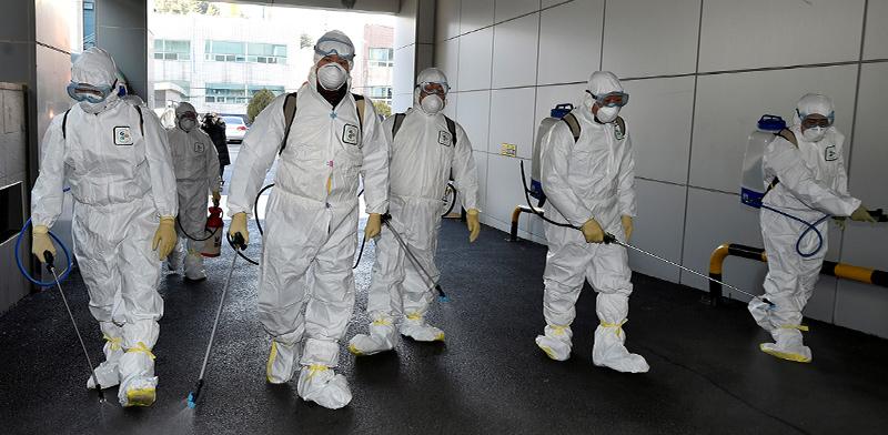 Disinfecting against the virus  / Photo: Yonhap Reuters , Reuters