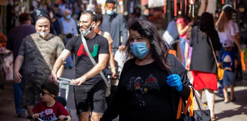 הרחוב הישראלי שוקק בימי קורונה, לאחר שחרור ההגבלות / צילום: Ariel Schalit, Associated Press