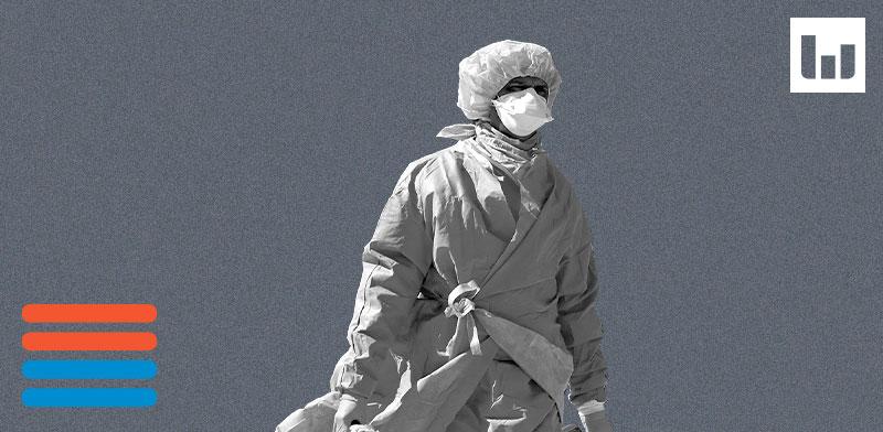 """חבר מהצוות הרפואי בבית חולים בניו יורק, ארה""""ב / צילום: רויטרס"""