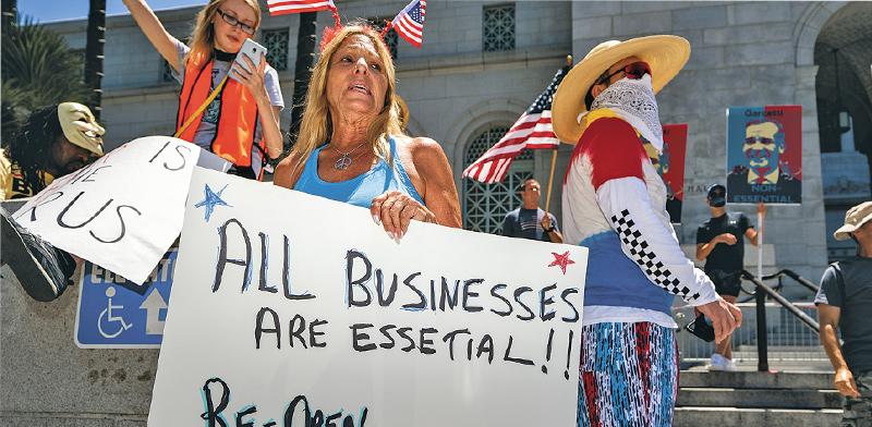 """הפגנה בארה""""ב במחאה על הסגר / צילום: Ronen Tivony, רויטרס"""