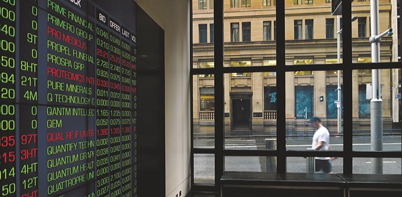הבורסה בסידני, אוסטרליה / צילום: JOEL CARRETT, רויטרס