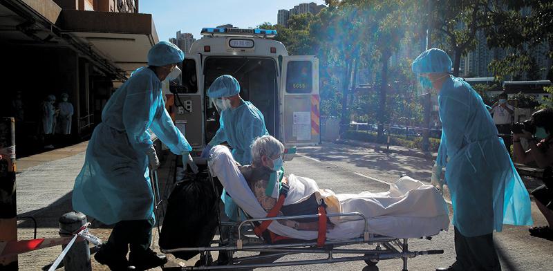 הונג קונג. הגל השני הגיע אחרי שכבר היו בטוחים שהם התגברו על המגפה / צילום: Kin Cheung, Associated Press