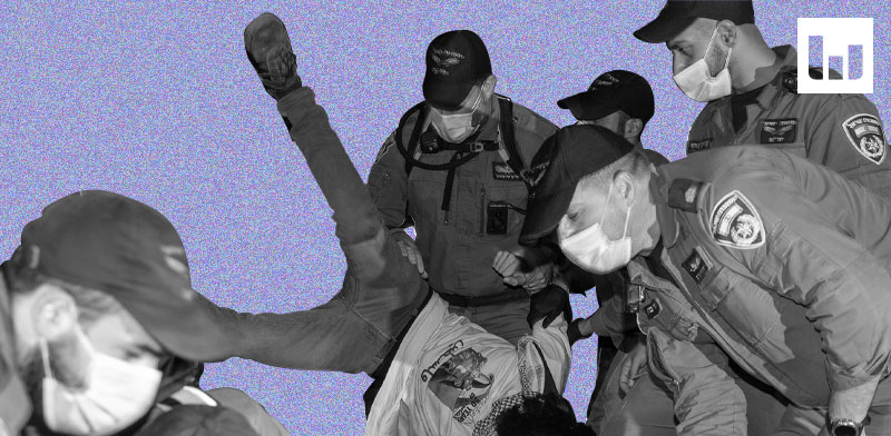 שוטרים בהפגנה בבלפור / צילום: Ariel Schalit, Associated Press