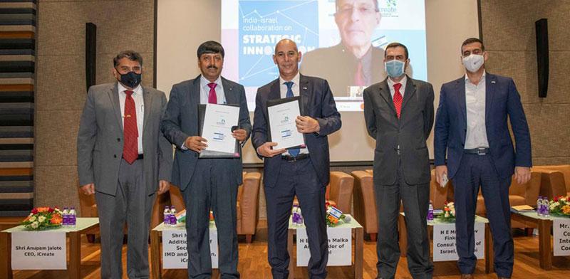 Unmasked - iCreate chairman Manoj Kumar Das and Ambassador Ron Malka. On screen - Eugene Kandel  / Photo: iCreate