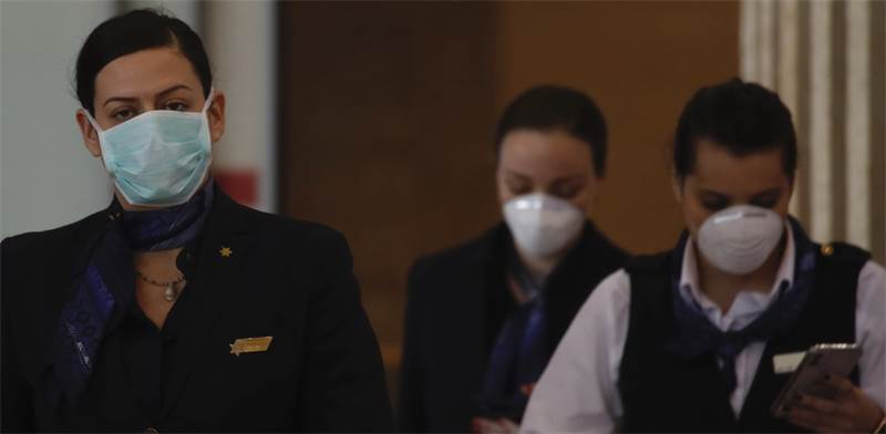 דיילות אל על בצל חשש הקורונה / צילום: Ariel Schalit, Associated Press