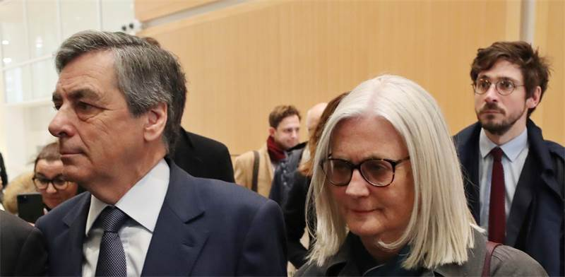 פרנסואה פיון ואישתו / צילום: Thibault Camus, AP