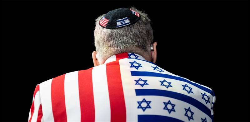 """משתתף בועידת איפא""""ק / צילום: מייקל ברוצ'שטיין, רויטרס"""