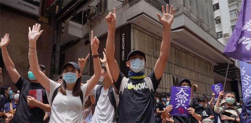 מפגינים בהונג קונג נגד נסיונות החקיקה החדשים של סין / צילום: Vincent Yu, AP