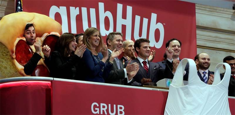 הנהלת Grubhub מצלצלת בפעמון פתיחת המסחר בוול סטריט / צילום: Richard Drew, Associated Press