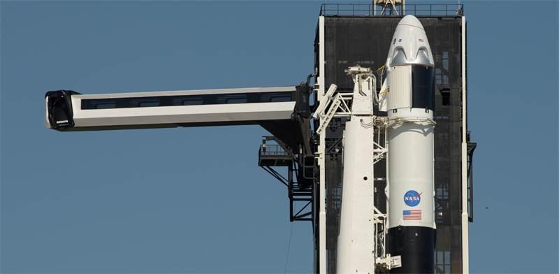 """חללית השיגור של נאס""""א וספייסX / צילום: ביל אינגלס, AP"""