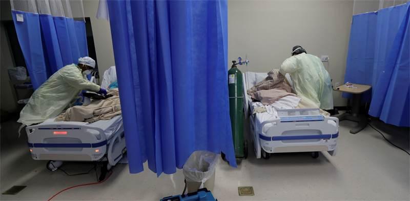 """טיפול בחולי קורונה בבית חולים בטקסס, ארה""""ב / צילום: Eric Gay, AP"""