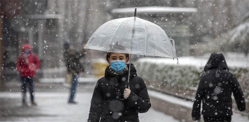 בהלת וירוס הקורונה בבייג'ינג, סין / צילום: Mark Schiefelbein, Associated Press