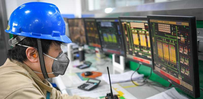 מפעל דגנים במחוז חיילונגג'יאנג בסין ששב לפעילות / צילום: רויטרס, Wang Song
