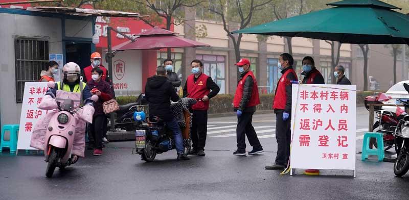 שער בכניסה לשכונה בעיר שנחאי / צילום: רויטרס ALY SONG